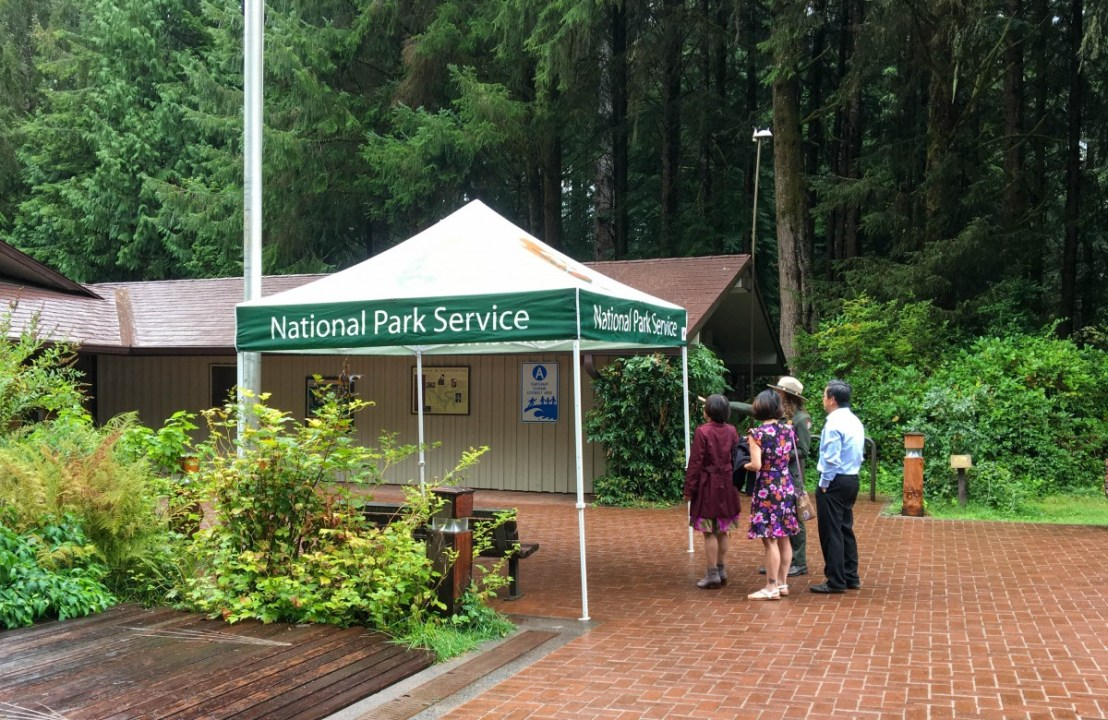 Park Service Employees Greet Immigrants and Direct Them To Naturalization Ceremony
