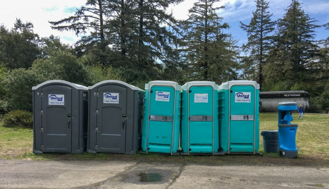 Portable Restrooms Lined Up For Servicing Visitors