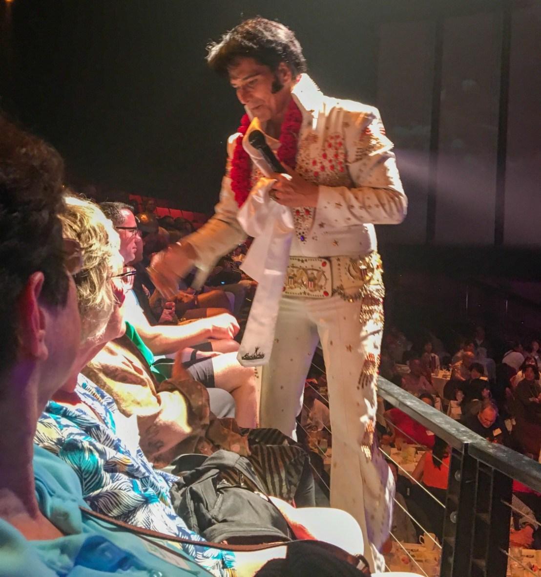 Elvis Presley Impersonator Handing Out Scarves