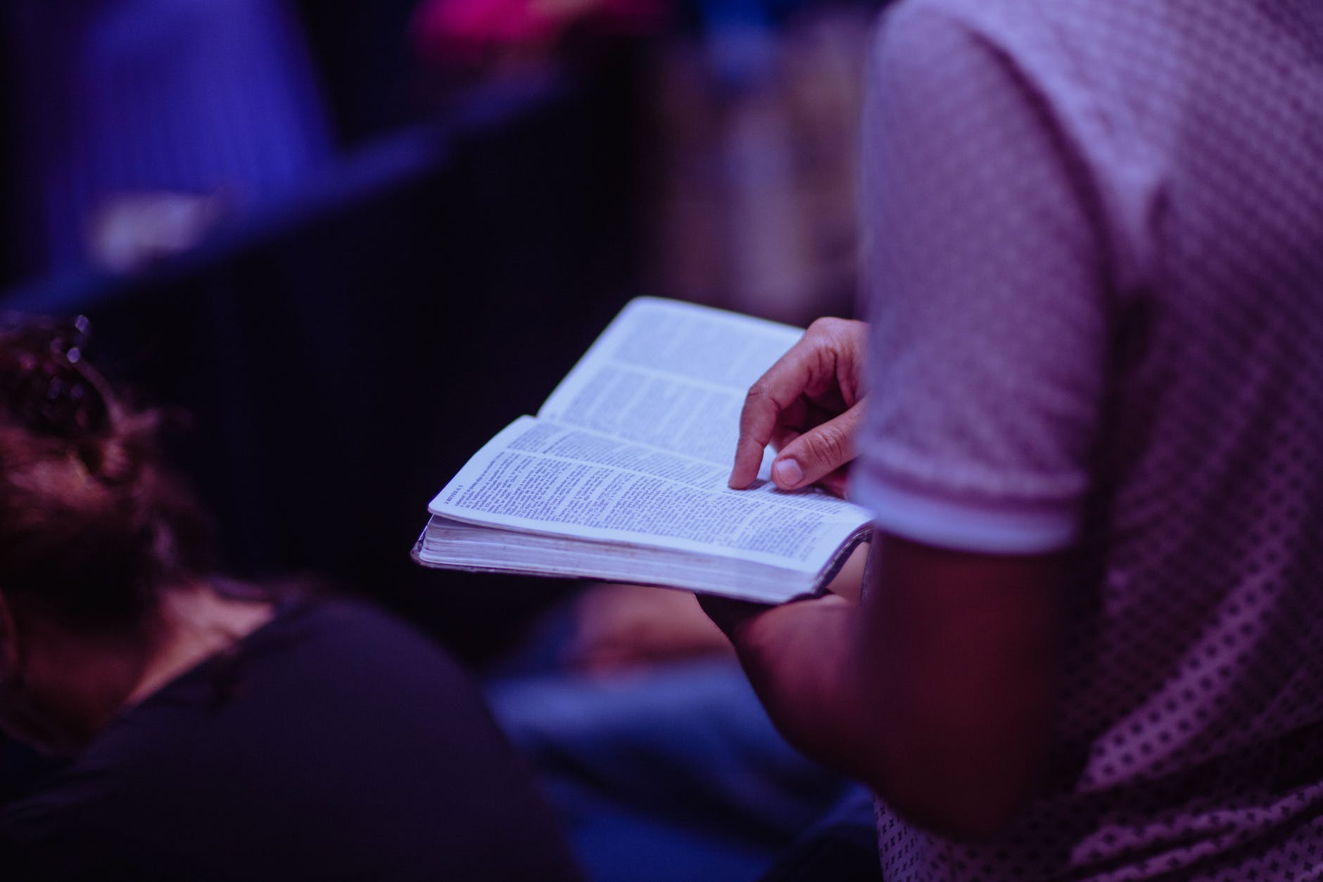 selective focus photo of person holding book