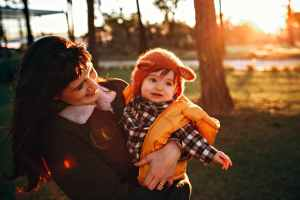 happy woman with son in park
