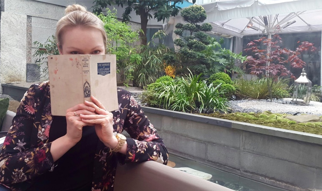 reading the afternoon tea menu at the Sanderson hotel