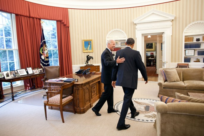 President Barack Obama and Vice President Joe Biden head toward the Oval Office Private Dining Room for lunch, June 8, 2011. (Official White House Photo by Pete Souza) This official White House photograph is being made available only for publication by news organizations and/or for personal use printing by the subject(s) of the photograph. The photograph may not be manipulated in any way and may not be used in commercial or political materials, advertisements, emails, products, promotions that in any way suggests approval or endorsement of the President, the First Family, or the White House.