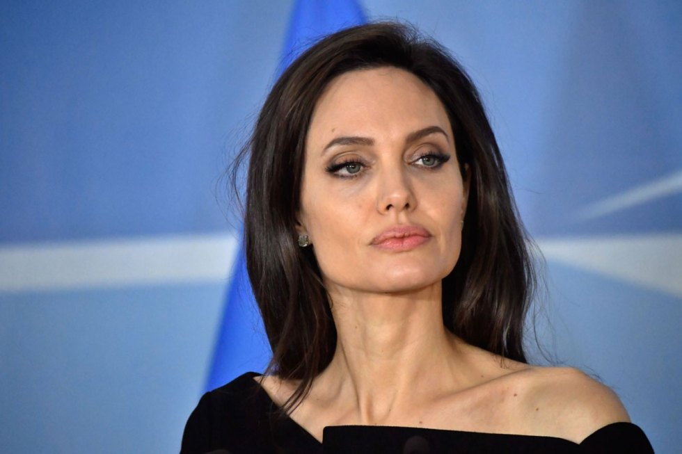 US actress and Special Envoy for the United Nations High Commissioner for Refugees (UNHCR) Angelina Jolie poses at the NATO Headquarters in Brussels ahead of a meeting with the NATO Secretary General on January 31, 2018.  / AFP PHOTO / Belga / DIRK WAEM / Belgium OUT        (Photo credit should read DIRK WAEM/AFP/Getty Images)