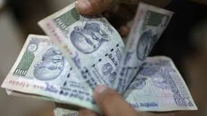 Indian rupee tumbles to record new low against the dollar