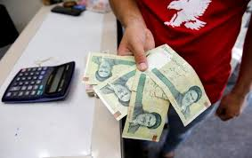 Iranian rial hits record low at 128,000 to the dollar