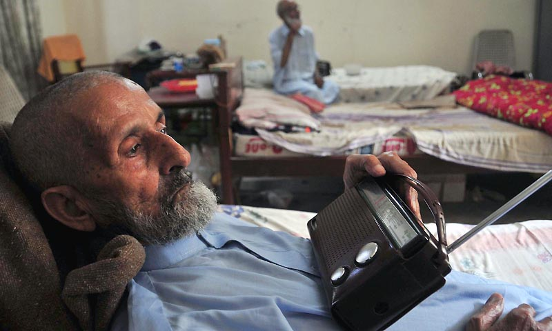 RAWALPINDI: An old man listening radio in a Welfare Home for Old and Infirm Persons Sadiqabad at as world observed International Day of Older Persons. INP PHOTO by Raja Imran