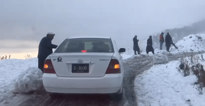 Tourists throng snow-covered hill tops in Dir after heavy snowfall