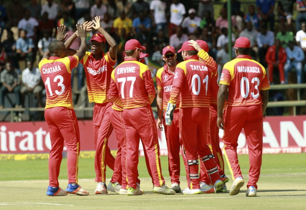 FILE - In this Thursday, March 22, 2018 file photo, Zimbabwe players celebrate the wicket of UAE batsman Ashfaq Ahmed during their cricket world cup qualifier match at Harare Sports Club. Zimbabwe has been suspended from international cricket because of government interference. The International Cricket Council says on Thursday, July 18, 2019 it is also freezing all funding to the southern African country, which is a test-playing nation and full member of the ICC. (AP Photo/Tsvangirayi Mukwazhi, file)