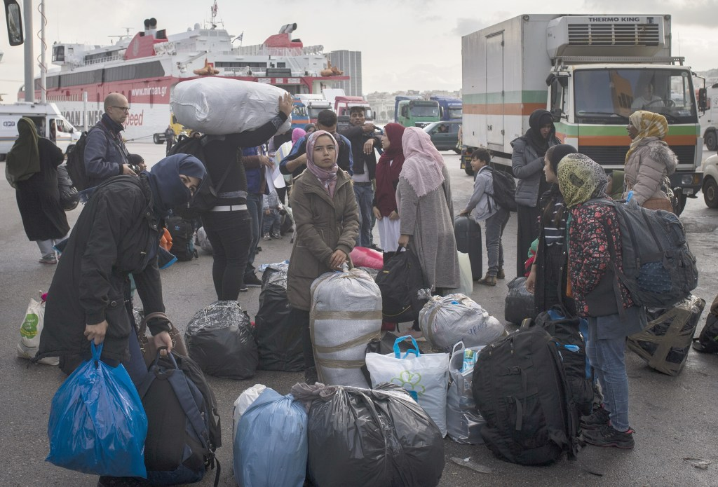 ATHENS, GREECE - NOVEMBER 07: Irregular migrants, include Afghans, Syrians and others, are seen with their belongings as they continue to move from the islands to the mainland at the Port of Piraeus in Athens, Greece on November 07, 2019. A total of 168 irregular migrants, 133 from Mytilene and 35 from Chios, were brought to the Port of Piraeus on a ''Diagoras'' cruise ship. ( Ayhan Mehmet - Anadolu Agency )