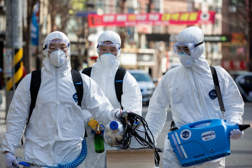 SEOUL Employees from a disinfection service company sanitize a shopping district in South Korea.