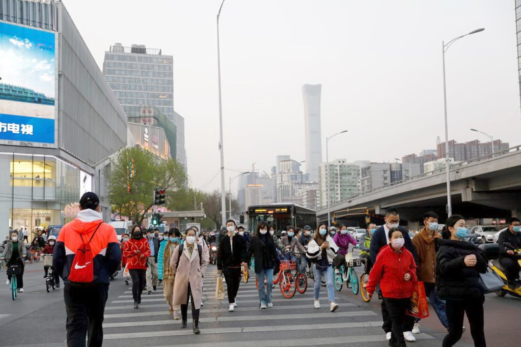 BEIJING People wearing protective face masks cross a street, following an outbreak of the coronavirus disease, in China.