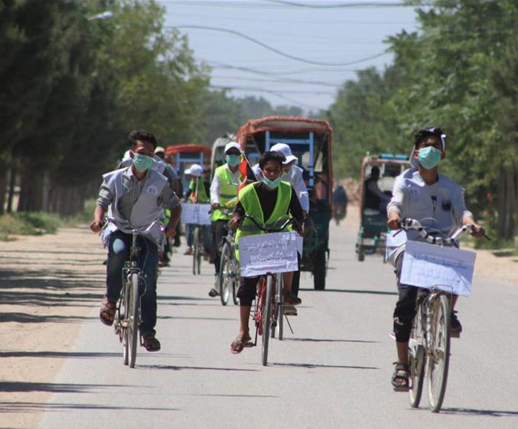 SHIBERGHAN CITY Afghans ride bicycles during a cycling event to mark the World Environment Day.