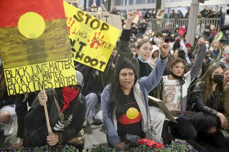 SYDNEY People protest in solidarity with those in the United States protesting police brutality and the death in Minneapolis police custody of George Floyd, in Australia.