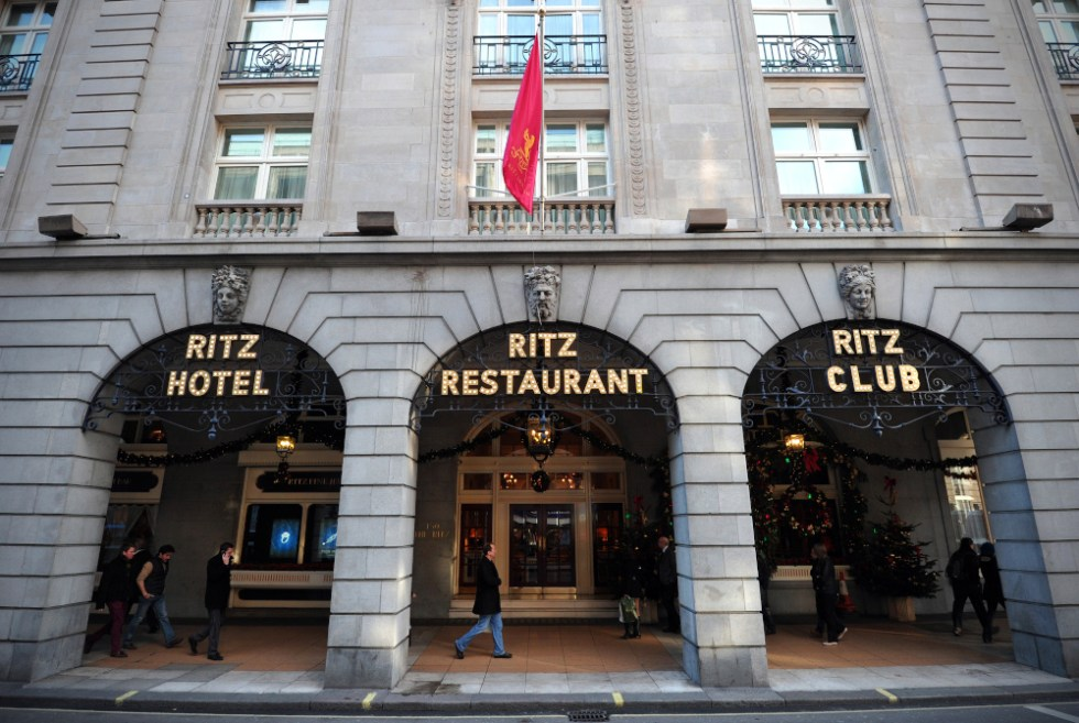 (FILES) In this file photo taken on December 17, 2012 people walk past the Ritz hotel in central London. - The London Ritz, a famous luxury hotel, was sold to an investor in Qatar by the wealthy Barclay brothers who are tearing themselves apart around this sale, for close to £800 million. The sale was announced by the British law firm Macfarlanes, which advised the Qatari investor, whose name has not been released. (Photo by Carl COURT / AFP)