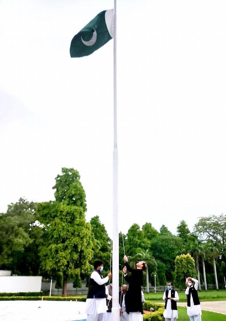 APP22-14 DELHI: August 14 - Acting High Commissioner Syed Haider Shah hoisting flag on Independence Day of Pakistan. APP