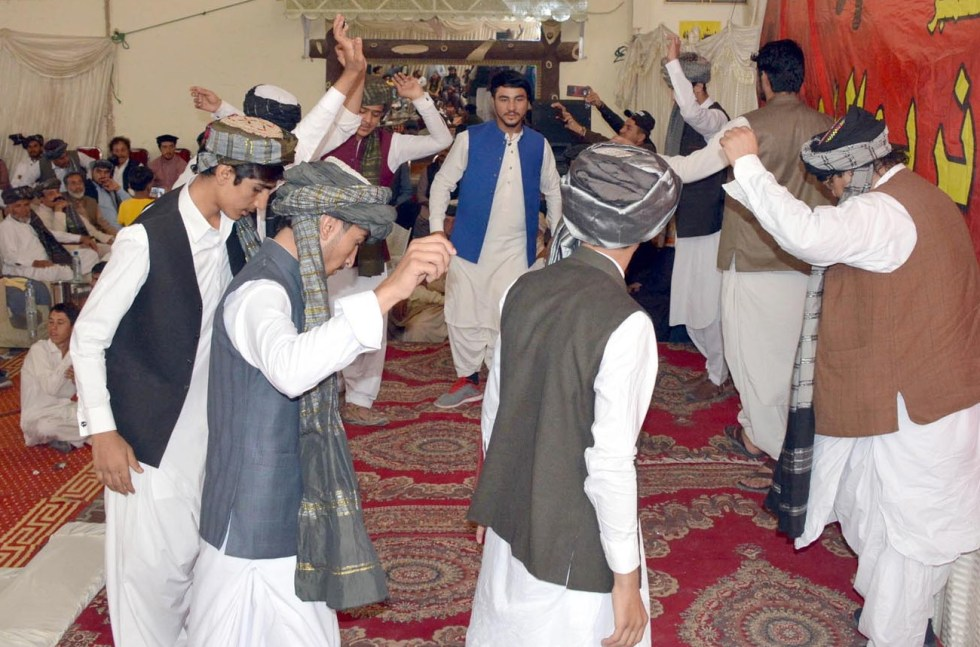 QUETTA: Youngsters presenting traditional on the occasion of Pashtun Culture Day ceremony. INP PHOTO by Ahmed Bhatti