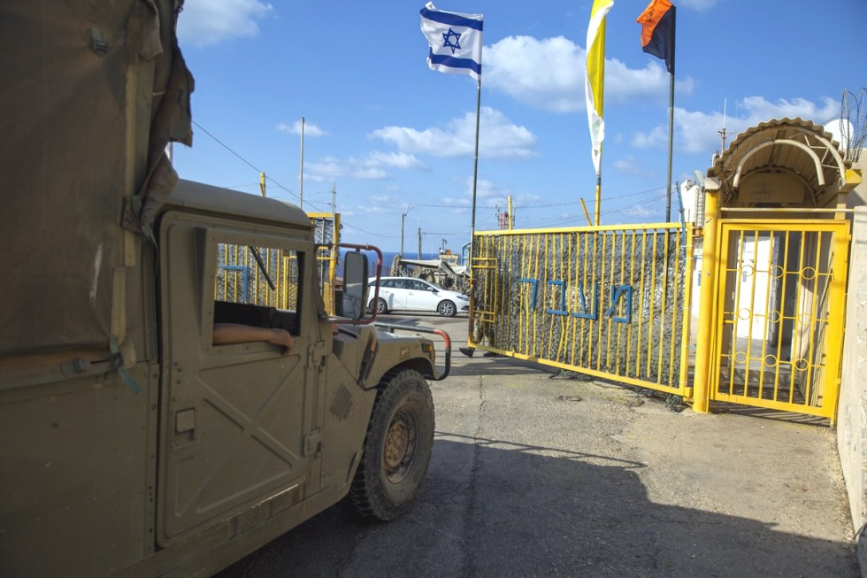 ROSH HANIKRA An Israeli soldier opens the gates of the Rosh Hanikra border crossing between Israel and Lebanon in northern Israel on October 14, 2020. AP Photo.