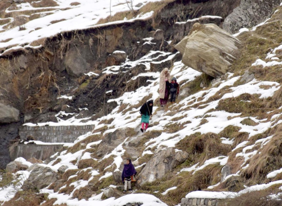 KAGHAN : Local resident walking on show fall area at Kaghan valley. INP PHOTO by Yasir Rajput
