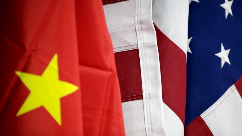 Flags of U.S. and China are displayed at American International Chamber of Commerce (AICC)'s booth during China International Fair for Trade in Services in Beijing, China, May 28, 2019. REUTERS/Jason Lee/File Photo