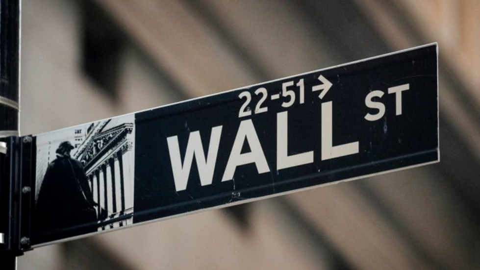 FILE PHOTO: A Wall St. sign is seen near the New York Stock Exchange (NYSE) in the financial district in New York, U.S., November 24, 2020. REUTERS/Brendan McDermid