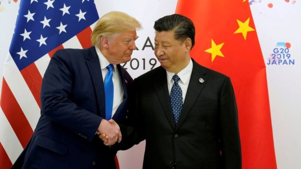 FILE PHOTO: U.S. President Donald Trump shakes hands with China's President Xi Jinping before starting their bilateral meeting during the G20 leaders summit in Osaka, Japan, June 29, 2019. REUTERS/Kevin Lamarque/File Photo