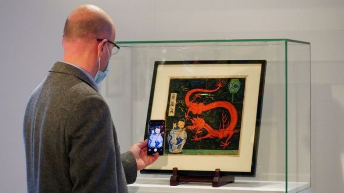 """Painting for the original cover of """"The Blue Lotus"""" (Lotus Bleu) Tintin comic book (1936), is displayed before being auctioned by Artcurial in Paris, France January 13, 2021. REUTERS/Noemie Olive"""
