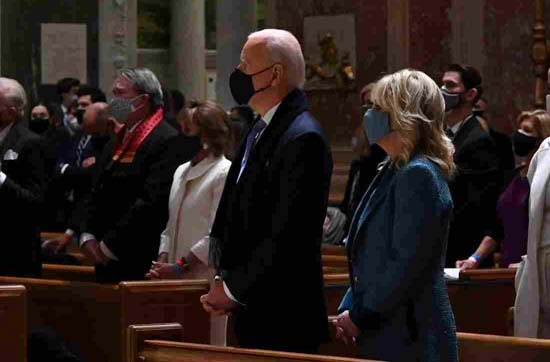 US President-elect Joe Biden (C) and incoming First Lady Jill Biden attend Mass at the Cathedral of St. Matthew the Apostle in Washington, DC, on January 20, 2021. - Biden is to be sworn in as the 46th US President at the US Capitol. (Photo by JIM WATSON / AFP) (Photo by JIM WATSON/AFP via Getty Images)