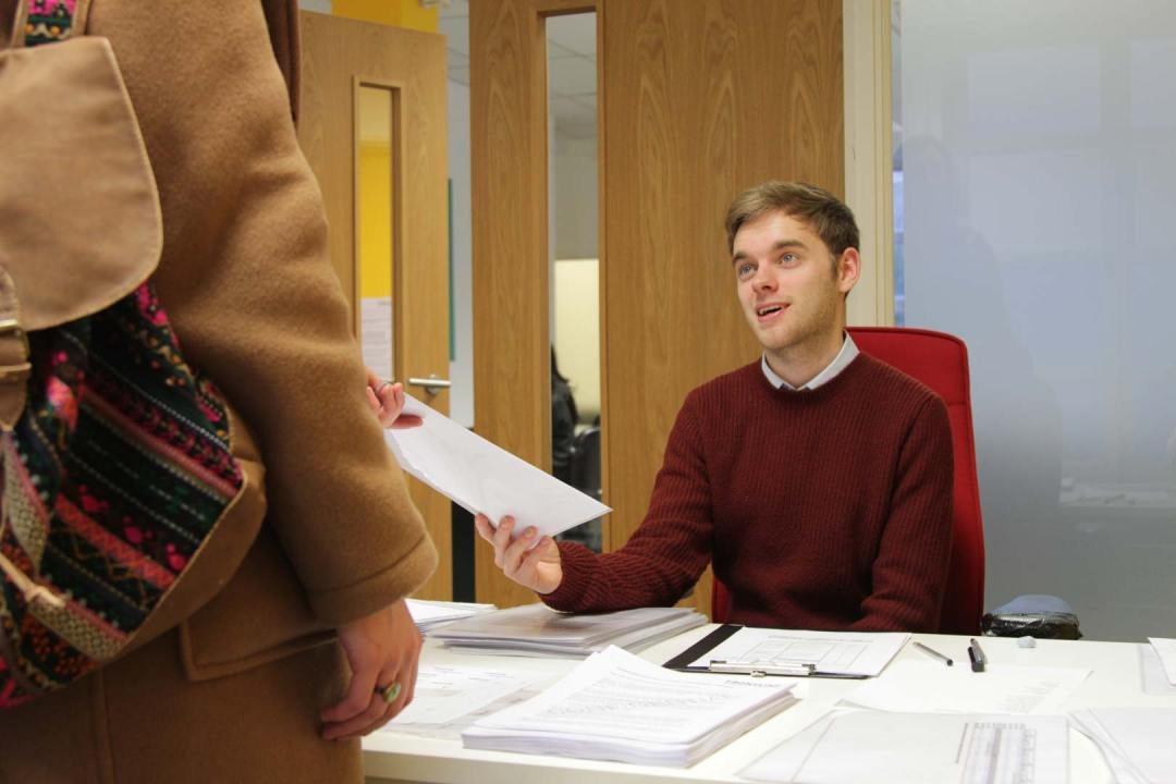 Ben greets a candidate at the assessment centre for the Frontline programme