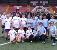 West & East Belfast: Kids from West (white) and East (blue) are pictured with Ulster Rugby stars Nick Williams and Neil McComb, as well as Community Rugby Coach Alasdair McKee, at the Belfast Interface Games Flagship event at Seaview on Friday evening