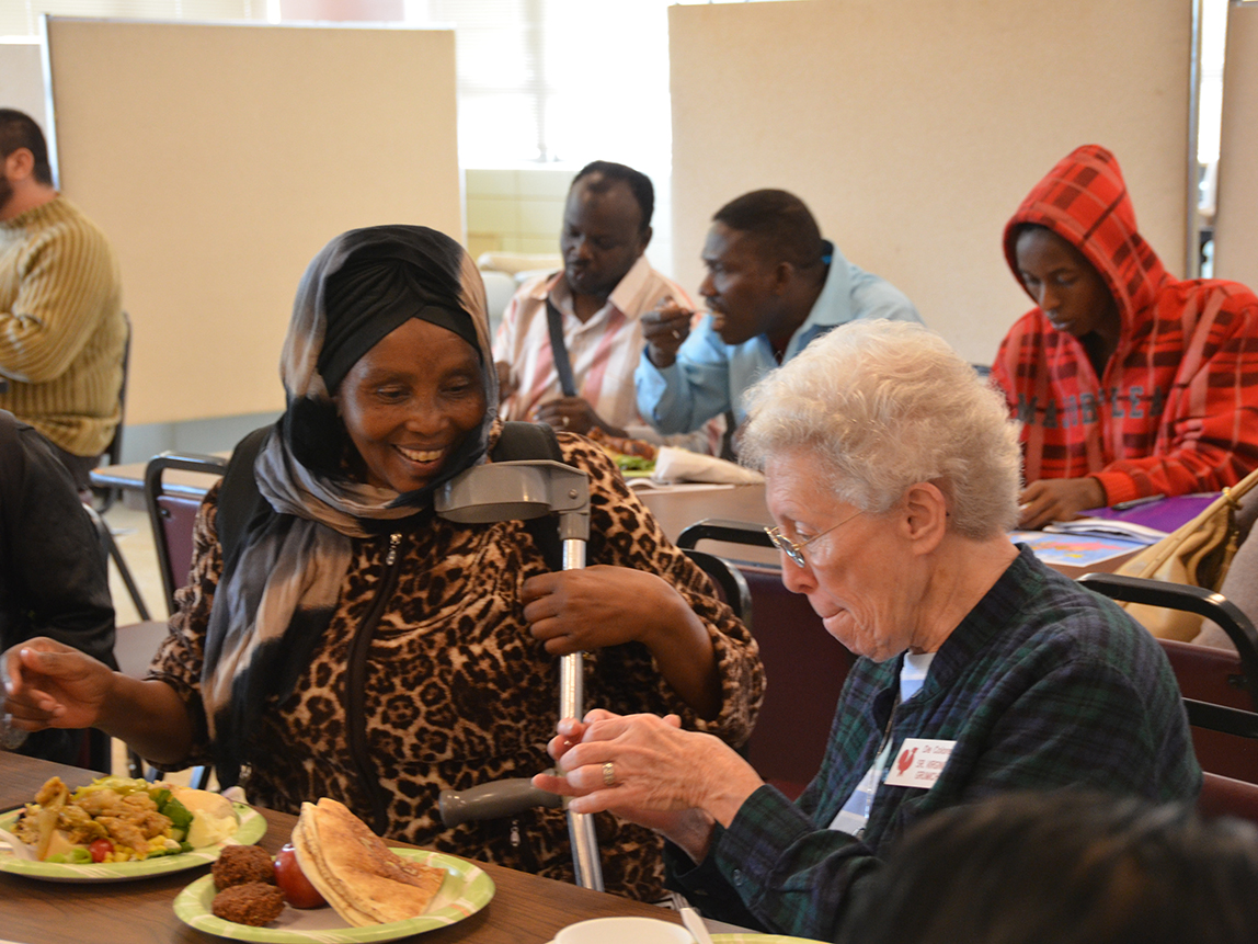 Sisters visit the International Institute once a month to bring bread to clients served by the nonprofit organization that serves immigrant and refugees new to St. Louis.