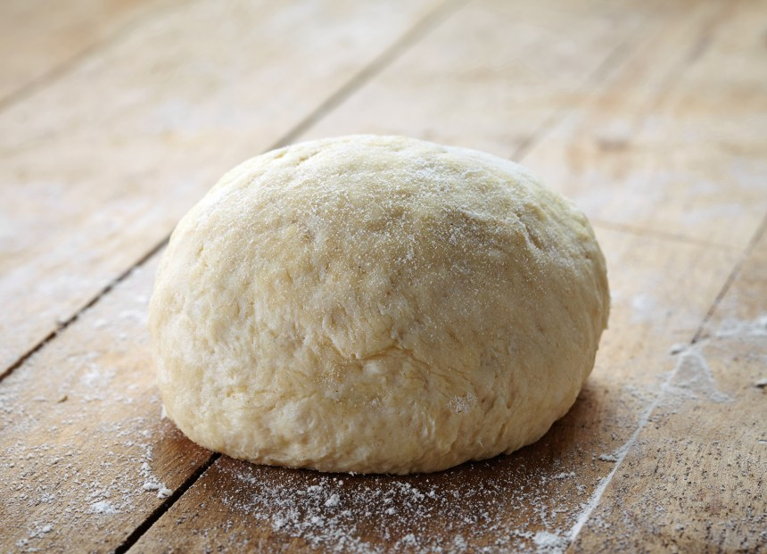 Ultimate no-fail pizza dough recipe. Start Sunday night, and have enough dough for 2-3 meals! Easy step-by-step directions. Make it today! From FrugalChicken