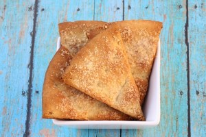 Garlic Parmesan Pita Chips Recipe at TheFrugalGirls.com
