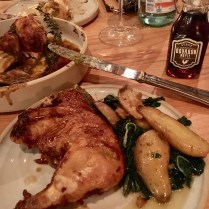 Herb Roasted Bird with side of Roasted Fingerling Potatoes and Mustard Greens