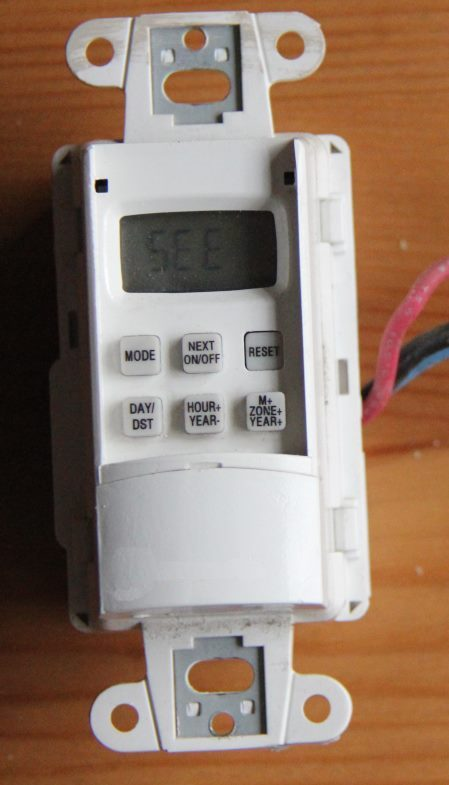 Digital timer. This type of timer is almost impossible to program without the instruction sheet, and the tiny display and buttons are difficult to work with.