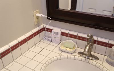 Motion-activated sound player in bathroom