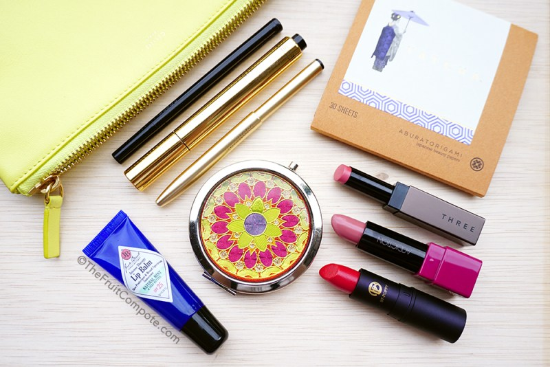 on-the-go-touch-ups-essentials-makeup-pouch-celine-trio-3