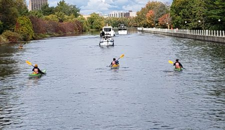 The kayakers paddling in the Rideau Canal