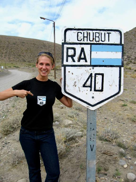 Gwen standing in front of a Route 40 sign wearing black t-shirt with Rt 40 logo