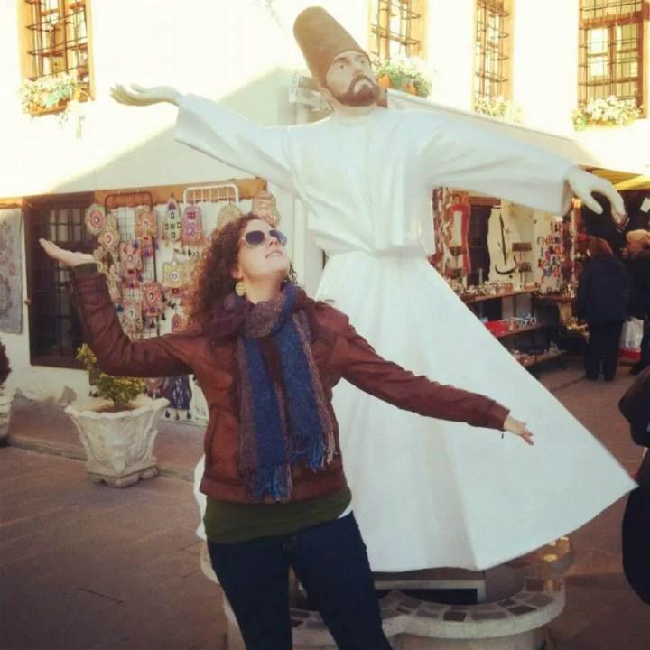 Emily emulating a whirling dervish statue