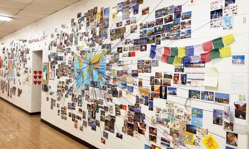 Wall of maps and postcards