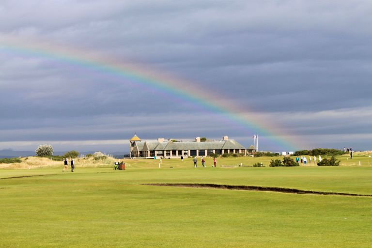 Rainbow over the Links Clubhouse with greens in the foreground