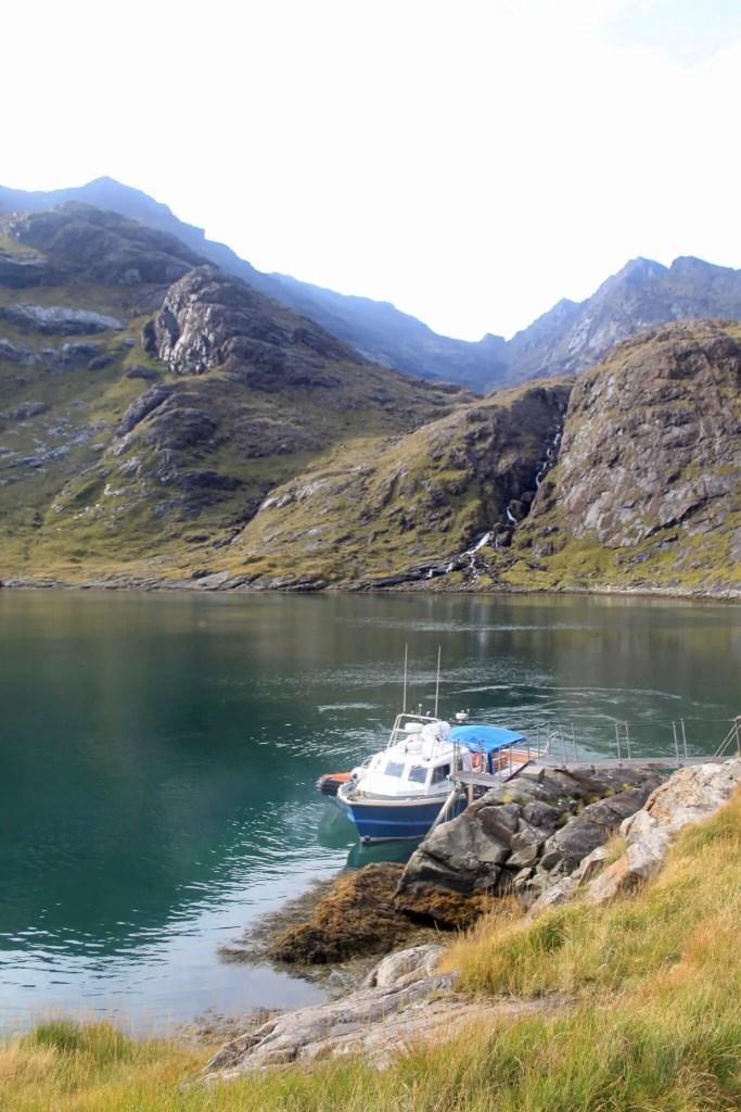 The Bella Jane docked among rocky hills