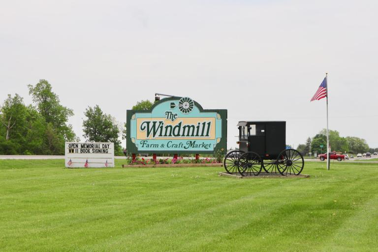 Sign for The Windmill, with buggy. Antiquing is a great pastime for your weekend getaway in the Finger Lakes.