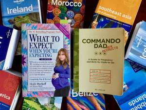 Parenting books on top of Lonely Planet travel guidebooks