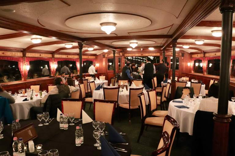 Tables and patrons on the dinner cruise