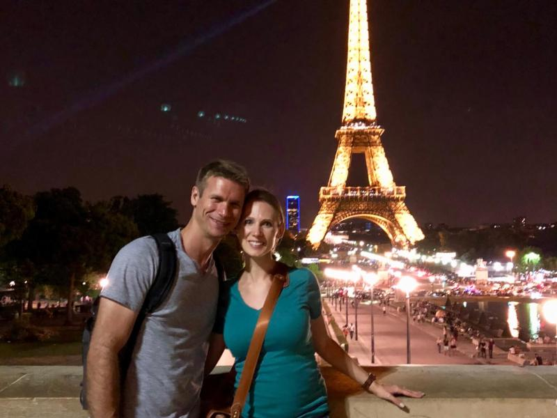 Gwen and M in front of the Eiffel Tower at night