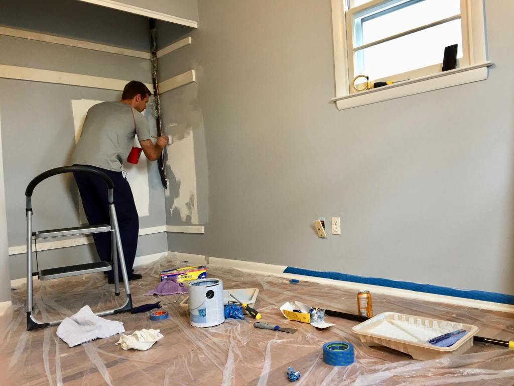 M painting the baby's room walls gray