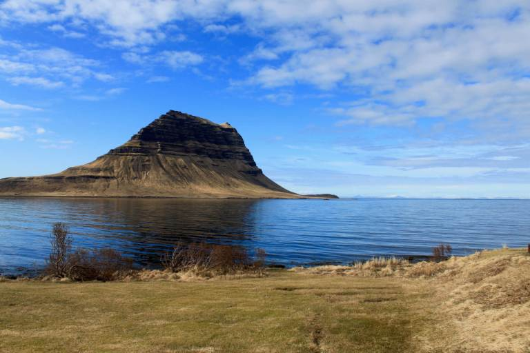 Kirkjufell with blue sky and water