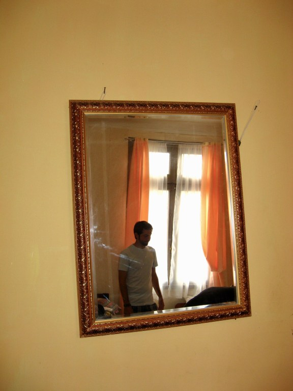 Curtis is reflected in a mirror knocked askew by the shaking